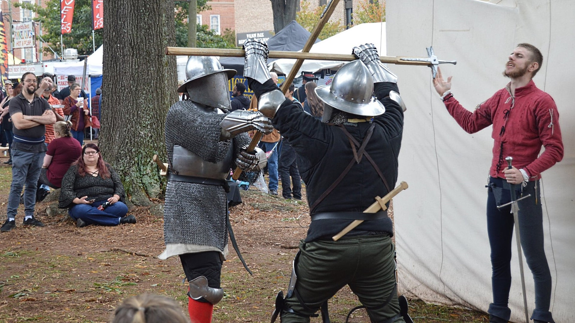 IMAGE: Demonstrating poleaxe at a faire